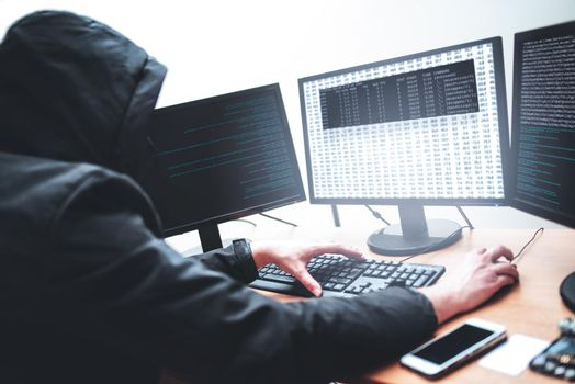 Picture of male hacker trying to steal information from system while looking at computer, isolated on white background
