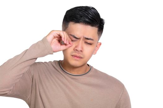 Tired Young man  rubbing   eyes .stress and frustration concept.
