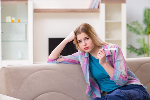 Young woman finding out about her pregnancy