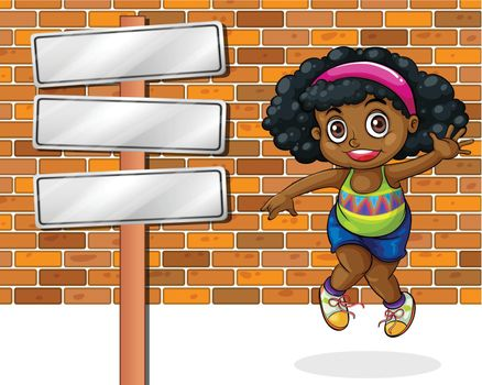 A girl jumping in front of the stonewall beside the empty signboard
