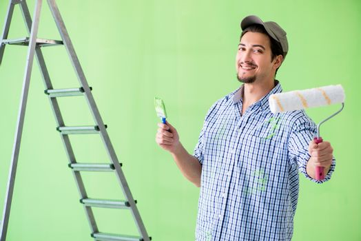 Young painter doing renovation at home