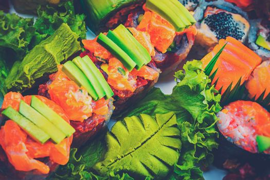 Abstract Food Background. Tasty Sushi Set. Fresh Delicious Raw Fish. Rolls and Sashimi. Traditional Japanese Meal. Healthy Organic Nutrition.