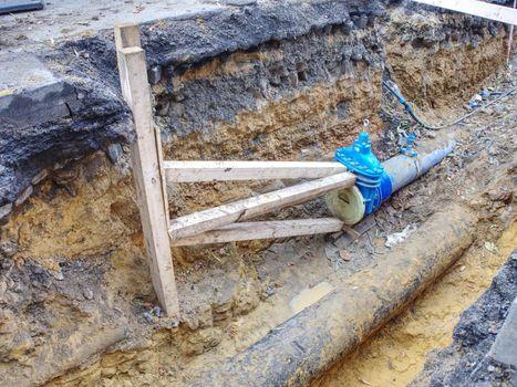 Building site. Repairing of water supply pipeline