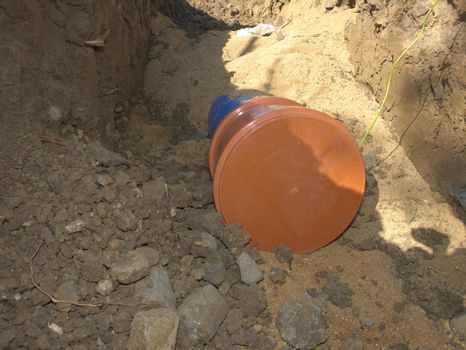 Plastic tube for portable water with safety cover in a trench