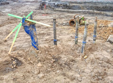 Laying control valve and water pipes in trench underground