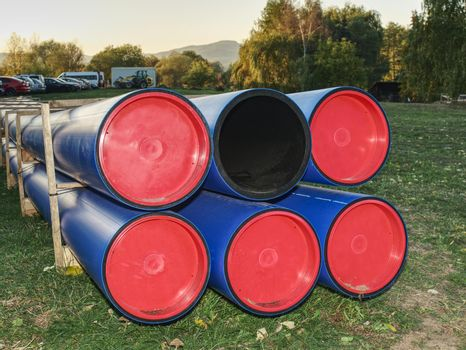 HDPE pipe for water supply stacked at building site  on ground
