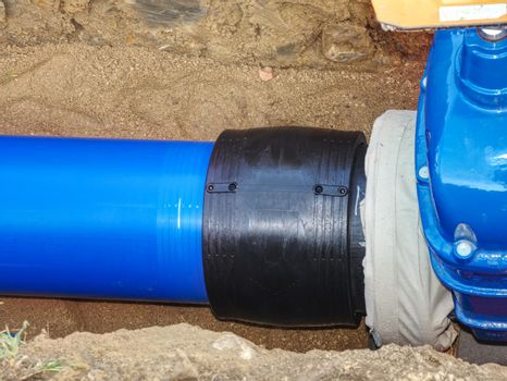 Welding of water supply plastic tubes excavation pit