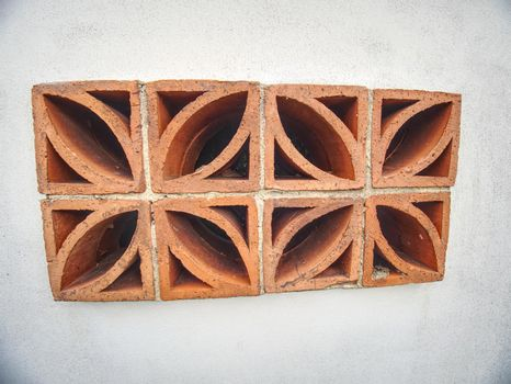 Red bricks with holes used into wall for air circulation