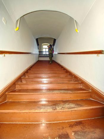 Wooden  starirs with handrail in the attic in a rustic interior