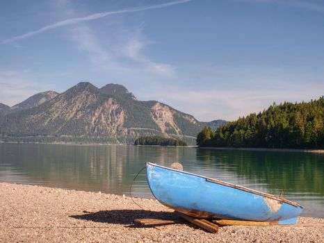 Boat on the stony shore of a mountain lake Walchensee.