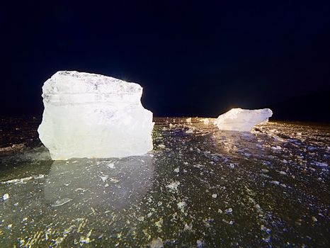 Icy winter landscape - thick ice covered ashore. Crashed ice floe