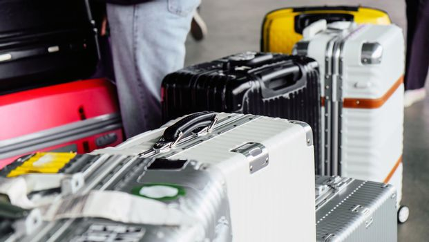 Pile of bag suitcases at airport terminal