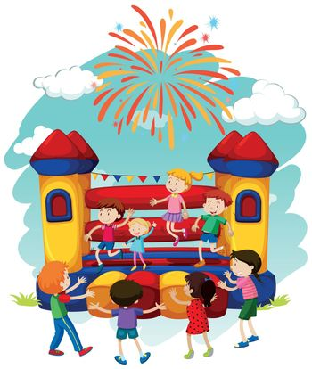 Many children jumping on bouncing castle