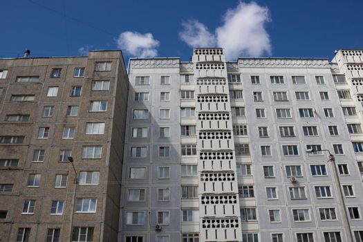 View from below on the facade of a modern multi-storey building with beautiful balconies
