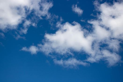Beautiful sky background. Oddly shaped clouds in a blue sky