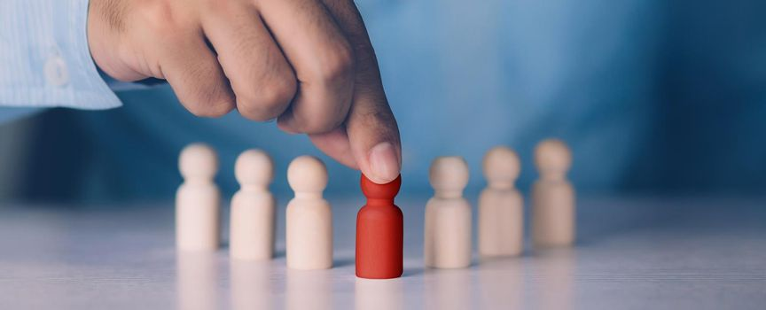 Hand of manager management human resource with recruitment and skill employee leader for corporate success, development and growth of leadership with unique, symbols of metaphor, business concept.