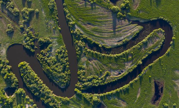 Aerial view of winding river bed with ducts.