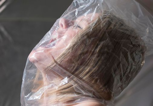 woman with bag over head symbolizing the feeling of claustrophobia