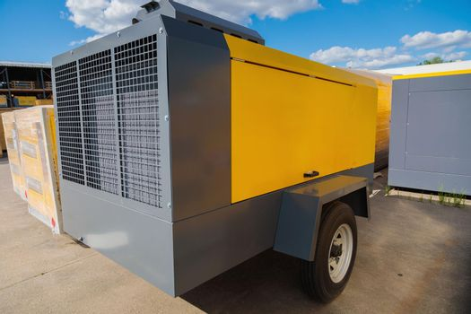 Mobile diesel compressor on wheels for supplying pneumatic air to devices