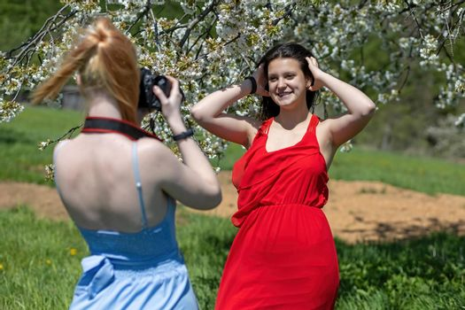 Photographing girlfriends in spring nature.