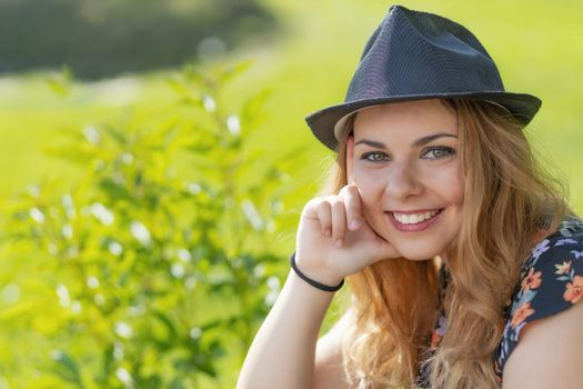 Portrait of beautiful smiling young woman in sunny day.