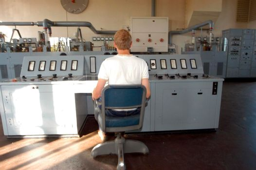 in an analog control room, controlling machines and working processes