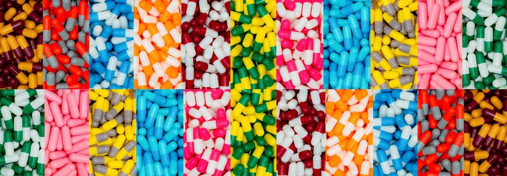 Top view of multi-color capsule pills. Pharmaceutical industry. Many antibiotics, painkillers, supplements capsule pills. Capsule pill production. Pharmacy banner. Drug selection. Pharmacy products.