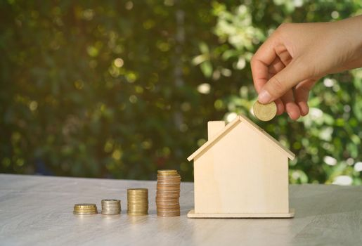 Abstract hand coin piggy bank house mockup concept auction real estate investment value, financial investment wealth, and business income growth.