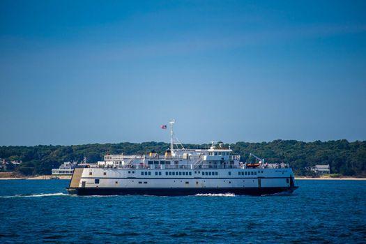Cape Cod Marthas Vineyard, MA, USA - Sept 4, 2018: The Martha's Vineyard bay ferry cruising along the shore of Cape Cod