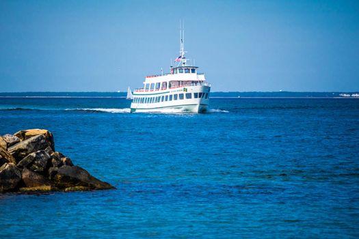 Cape Cod Marthas Vineyard, MA, USA - Sept 4, 2018: The Island Queen bay ferry cruising along the shore of Cape Cod