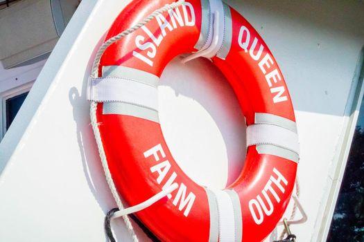 Cape Cod Marthas Vineyard, MA, USA - Sept 4, 2018: An orange life circle in case of emergency