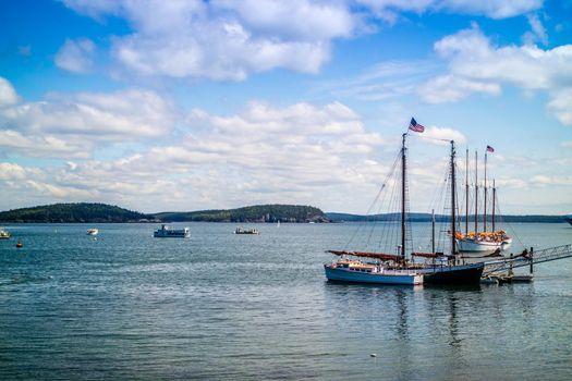 Bar Harbor, ME, USA - August 19, 2018: A sailing yacht boat cruising along the shore of Bar Harbor