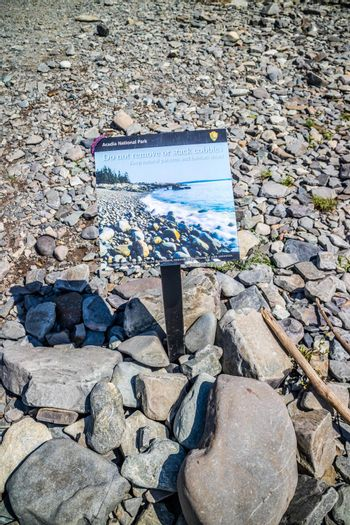 Bar Harbor, ME, USA - August 19, 2018: A reminder about removal or stacking of stones placard