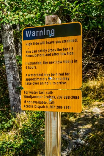 Bar Harbor, ME, USA - August 19, 2018: A warning in case of emergency placard