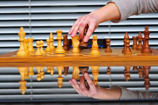 playing a game of chess, a strategic board game for two players