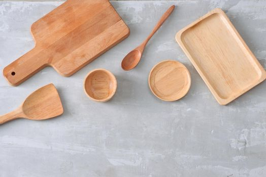 Set of wooden kitchenware on table