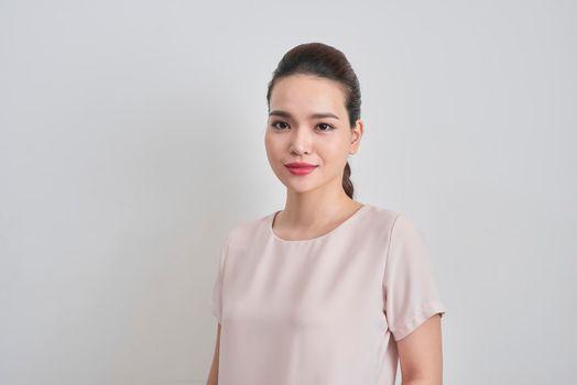 Portrait of cheerful pretty Vietnamese entrepreneur