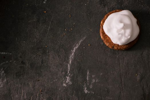 Cookies with cream cheese topping on rustic wooden table