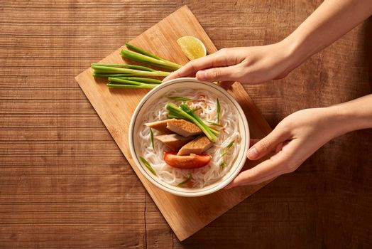 Vietnamese soup containing rice vermicelli and grilled chopped fish