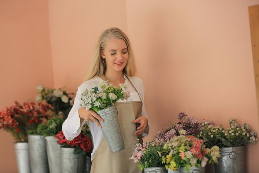 Portrait of confident young Asian female florist, owner of small business flower shop.