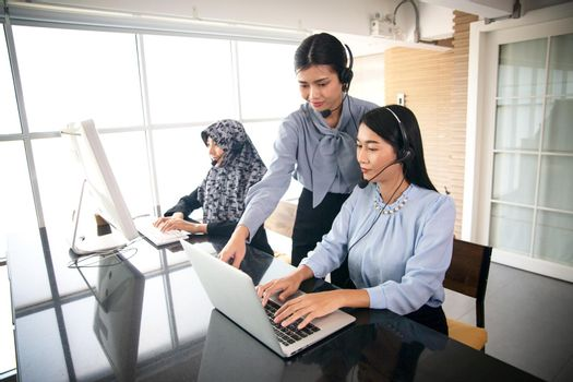 Colleagues working in a call center.