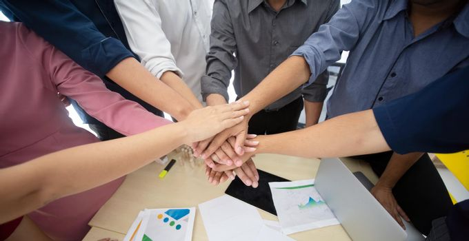 business people hands fist joined together as unity.