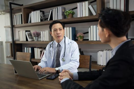 Professional medical doctors working in hospital office using computer technology. Medicine and healthcare.