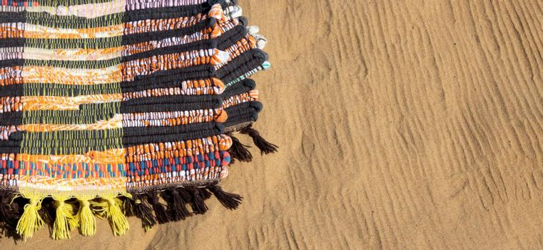 Traditional handmade rug. Here it is used as a beach blanket on the sand