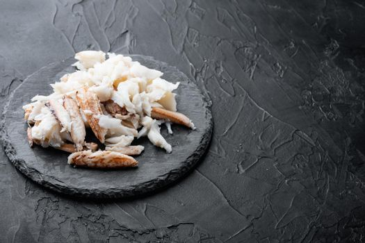 Boiled blue swimming crab parts, on black background , with copyspace and space for text