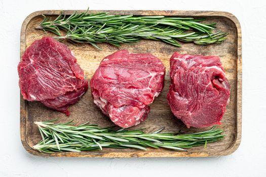 Prime Raw Fillet Mignon tenderloin steaks, on white stone surface, top view flat lay