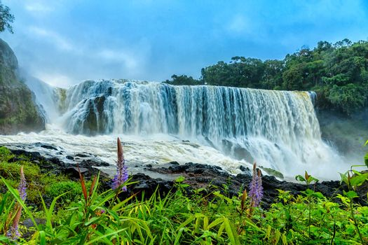 The powerful of Sae Pong Lai waterfall in Southern Laos.