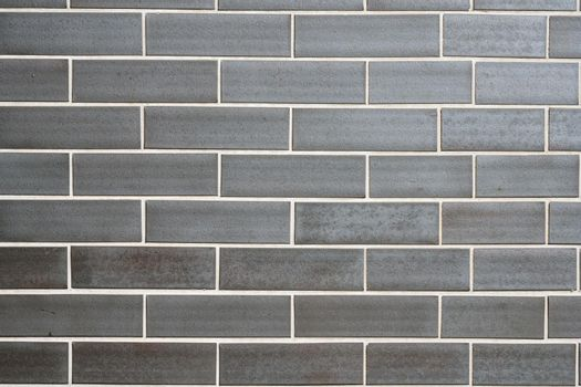 Wall made of grey clinker bricks