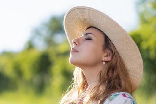 Side view of sunbathing beautiful young woman.