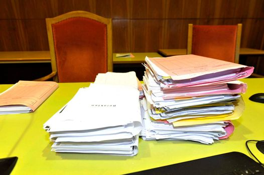 files and folders in the courtroom, justice cases on paper